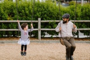 adult and child on swings