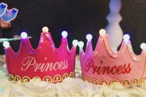 two pink princess crowns
